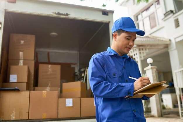 vietnamese moving house company courier standing delivery truck full boxes filling information contract 274689 17357